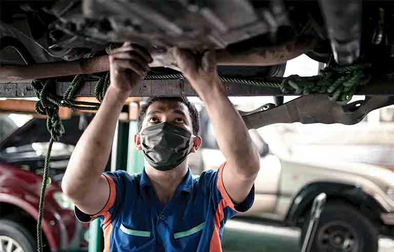 Mechanic wearing mask